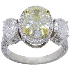 Light Yellow Oval Diamond Three-Stone Engagement Ring 6.44 Carat SI2 in Platinum