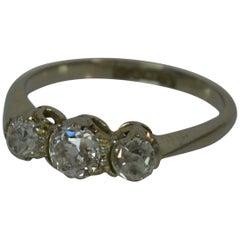 Antique 18 Carat Gold and 0.85 Carat Old Cut Diamond Trilogy Ring