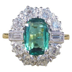 Emerald Diamond Cluster Engagement Ring in 18 Carat Gold