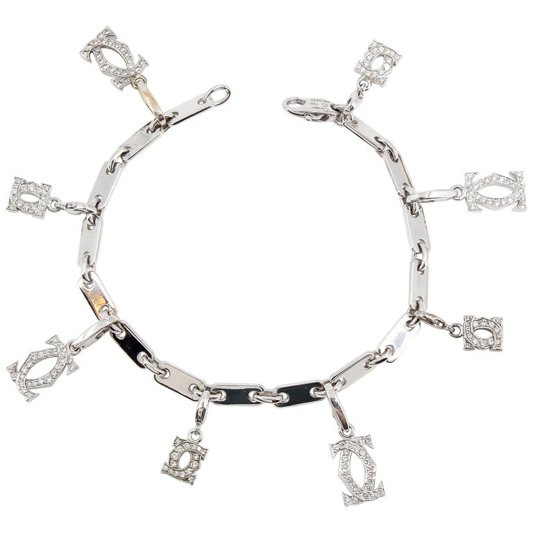 CARTIER Diamond and White Gold Charm Bracelet For Sale