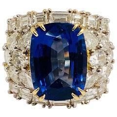 1990s 18 Karat Gem Quality Tanzanite and Diamond Ring