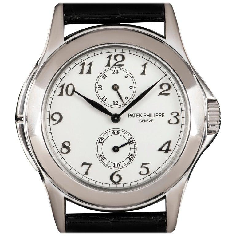 Patek Philippe White Gold White Dial Travel Time Manual Wristwatch Ref 5134G