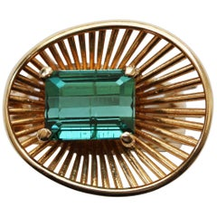 Gold Ring with Wirework and an Emerald Cut Green Tourmaline