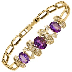 Diamond Bracelet with Three Oval Amethyst Set in 14 Karat White and Yellow Gold
