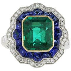 Platinum and 18 Karat Yellow Gold 3.68 Carat Emerald and Sapphire Ring