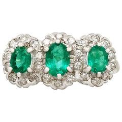 1994 1.45 Carat Emerald and Diamond Yellow Gold Trilogy Ring
