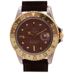 """Rolex Yellow Gold Stainless Steel """"Rootbeer"""" GMT self winding Wristwatch, c 1973"""