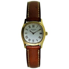 Patek Philippe 18 Karat Ladies Quartz Nautilus Style Strap Watch, circa 1990s