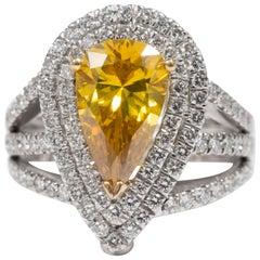 Pear Shape Yellow Diamond Ring in 18 Karat White Gold with White Diamonds