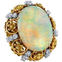 22.12 Carat Opal with 1.05 Carat Diamonds, 14 Karat Yellow Gold Ring