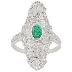 18 Karat White Gold Diamond and Emerald Navette Ring