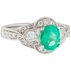 18 Karat White Gold Diamond and Emerald Ring