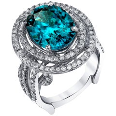 Oval 9.43 Carat Blue Zircon with 1.26 Carat Diamond 18 Karat White Gold Ring