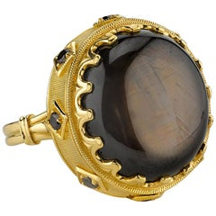 34.70 Carat Oval Black Star Sapphire & .28 Carats Black Diamonds 18k Gold Ring