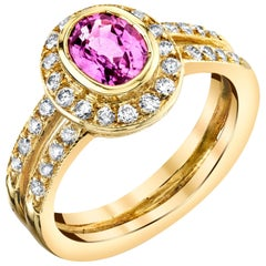 1.14 Carat Oval Pink Sapphire and .57 Carat Diamonds 18 Karat Yellow Gold Ring