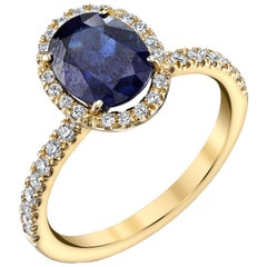 2.16 Carat Oval Blue Sapphire and .24 Carat Diamonds 18 Karat Yellow Gold Ring
