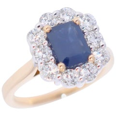 Sapphire and White Diamond Yellow and White Gold Engagement Ring