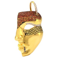 18K Yellow Gold Mask Pendant Red, Yellow & Orange Sapphires & Natural Diamonds