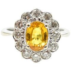 1.41 Carat Oval Cut Yellow Sapphire and Diamond Halo 18 Karat White Gold Ring