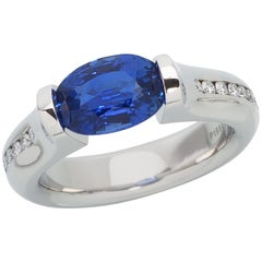 Steven Kretchmer Omega Channel Ring with a Tension-Set Blue Sapphire