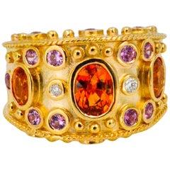 14 Karat Yellow Gold Wide Band Bezel Set 3.32 Carat Orange Sapphire Ring