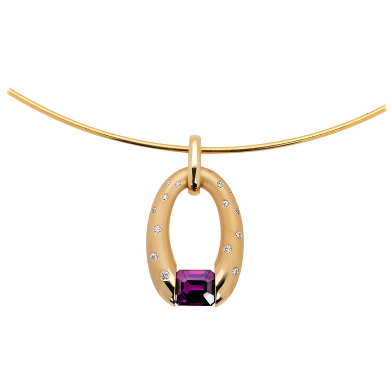 Yellow Gold Oval Pendant with Tension-Set Magenta Sapphire