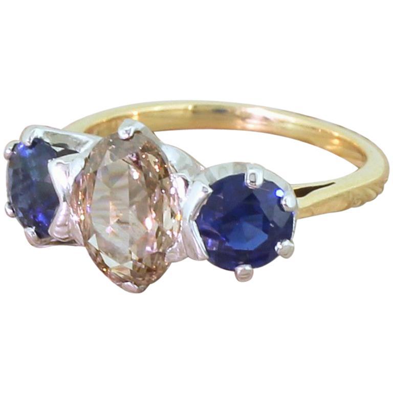 Midcentury 1.46 Carat Fancy Intense Brown Diamond and Sapphire Trilogy Ring