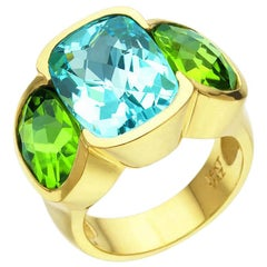 6.10 Carat Blue Topaz and 6.20 Carat Peridot Three-Stone Ring