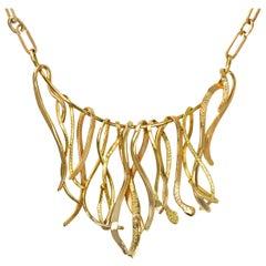 1979 Elon Arenhill, Gold Bib Necklace