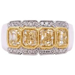 2.38 Carat Fancy Yellow Radiant Cut Four-Stone Diamond Ring in 18 Karat Gold