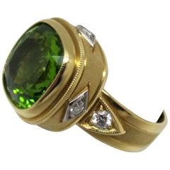 7.18 Carat Peridot with .05 Carat Diamonds 18 Karat Yellow Gold Ring