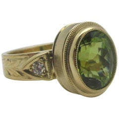 3.27 Carat Oval Peridot and .10 Carat Diamonds 18 Karat Yellow Gold Ring