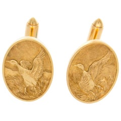14 Karat Disc Cufflinks with a Flying Duck Motif and Toggle Backs