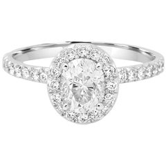 GIA Certified 1.01 Carat Oval Diamond Halo Gold Platinum Engagement Ring