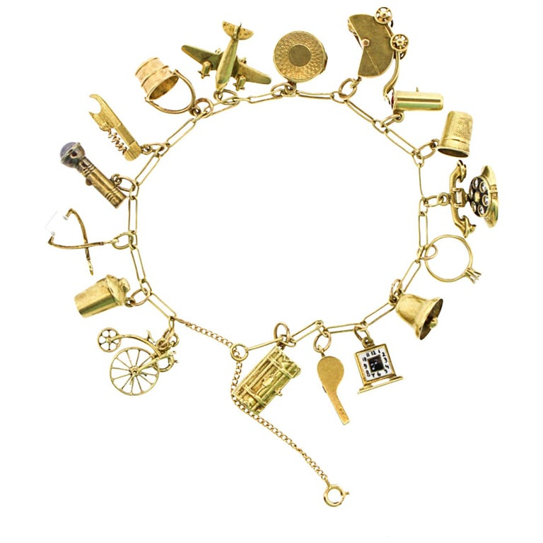 Retro 14 Karat Yellow Gold Charm Bracelet With Moving Charms For