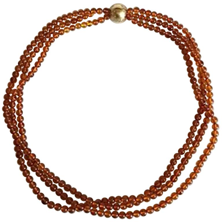 Ole Lynggaard Three-Piece Necklace in Amber with Ball-Lock in 18 Karat Red Gold