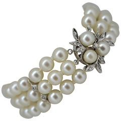 Triple Strand AAA Akoya Pearl Bracelet with White Gold and Diamond Floral Clasp