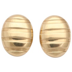 1980s Oval Shaped High Polish Ridged Gold Textured Earclips with Posts