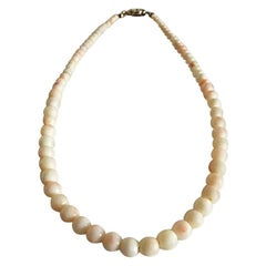 Pearl Necklace with Ivory and Lock of Gilded Sterling Silver