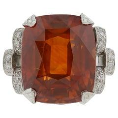 Platinum GIA Certified 25.56 Carat Orange Sapphire and Diamond Ring