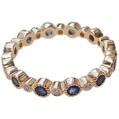 18 Karat Gold Eternity Band, 0.73 Carat of Sapphire, 0.12 Carat of Diamond