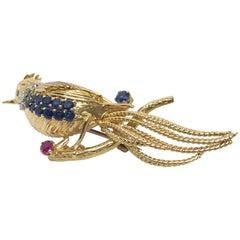 Kutchinsky 18 Karat Gold, White Diamond, Blue Sapphire and Ruby Bird Brooch