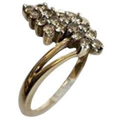 Gold Ring in 14 Karat with 16 Small Stones