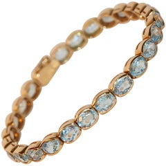 14 Karat Yellow Gold Aquamarine Tennis Bracelet, Set with 26 Aquamarines
