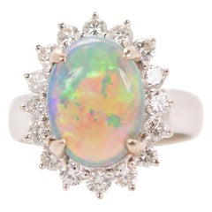 GIA Opal Oval Cabochon and Diamond Halo 18 Karat White Gold Engagement Ring