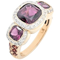 10 Karat Yellow Gold Tourmaline and Diamond Three-Stone Halo Ring