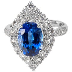 Halo Diamond and Oval Sapphire Ring in 18 Karat White Gold, 5.34 Carat