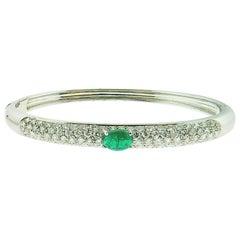 18 Karat White Gold Bangle with Emerald and Diamonds