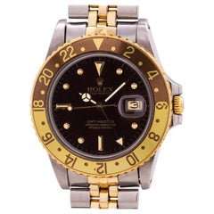 Rolex Yellow Gold Steel GMT Rootbeer dial self winding wristwatch, circa 1981