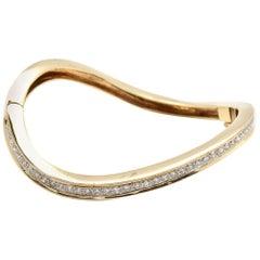 14 Karat Yellow Gold Twisted 1.68 Carat Diamond Hinged Bangle Bracelet